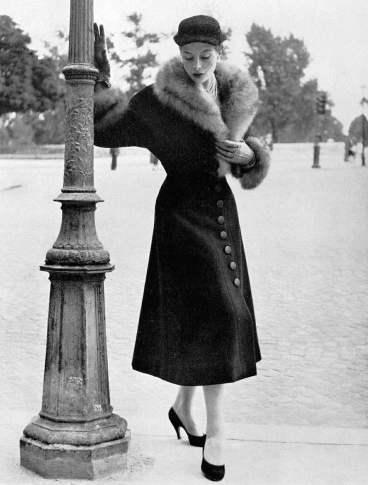 Capucine in black wool fur-trimmed coat by Manguin, photo by René Rouff, 1953. #vintage #1950s #coats #fashion