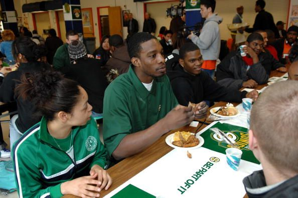 Jeff Green of the Seattle SuperSonics sits with students during a scholarship award lunch at Rainier Beach High School on March 25 2008 in Seattle...