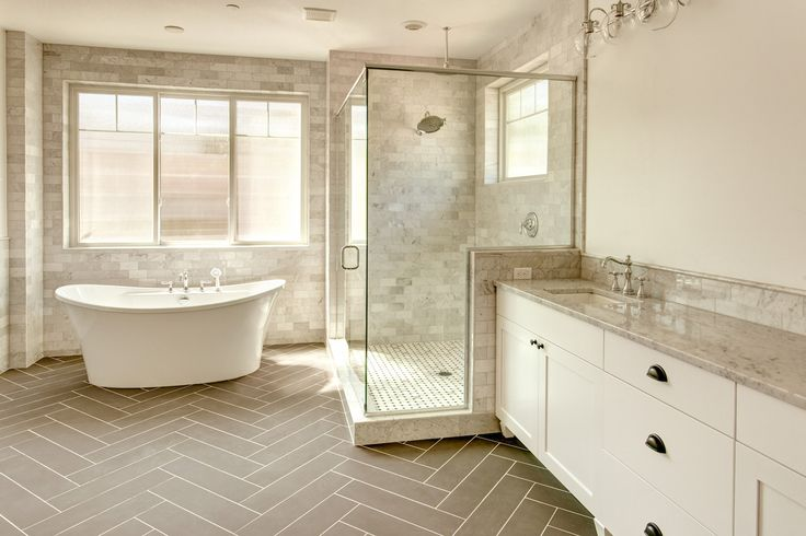 Have your bathroom look as good as you feel when in it. Semi frameless rain shower, and a one pice MAAX bathtub. With clouded windows to add natural light but still keep your privacy. By American Clasic Homes.