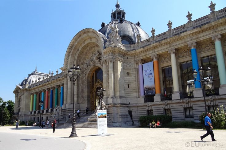 A photo showing the front facade of the Petit Palais, with its many multicoloured columns, arched entrance, elegant door and just some of the stone statues that can be seen from this angle.  See more Paris Photos at www.eutouring.com