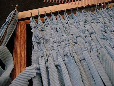 How to weave using fabric strips cut from old clothing.