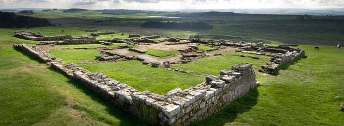 In Northumberland, England, Housesteads Roman Fort is one of the forts still standing along the length of Hadrian's Wall. As we studied in Module 8, this wall is built fourteen feet high in the English countryside and stands as a reminder that the Roman Empire managed to reach all the way to Great Britain. http://www.english-heritage.org.uk/daysout/properties/housesteads-roman-fort-hadrians-wall/