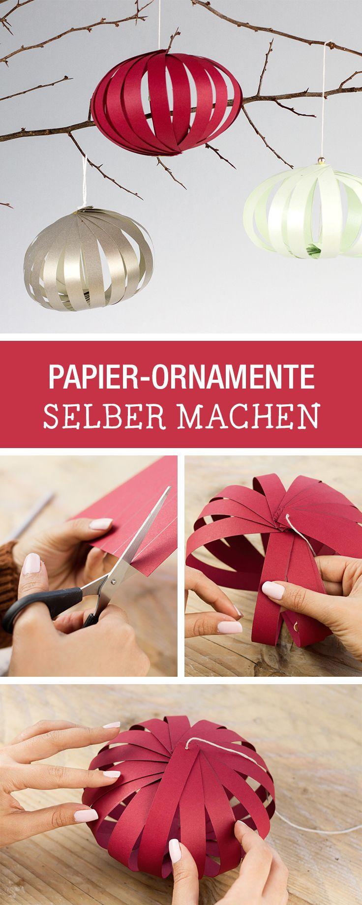 Christbaumkugeln aus Papier selbermachen / how to fold chirstmas glitter balls with paper strips via DaWanda.com