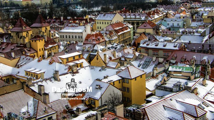 Lesser town Mala Strana snowy rooftops
