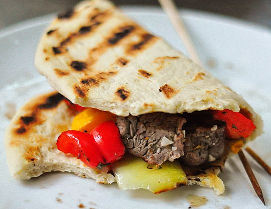rosemary-lemon kebabs with grilled flatbread! pizza or pita-bread dough; steak tips, squash, peppers, and onion for the kebabs; minced garlic and rosemary, salt, lemon, and olive oil for the marinade (yum); and yogurt or sour cream for spreading on the flatbread. yummy!