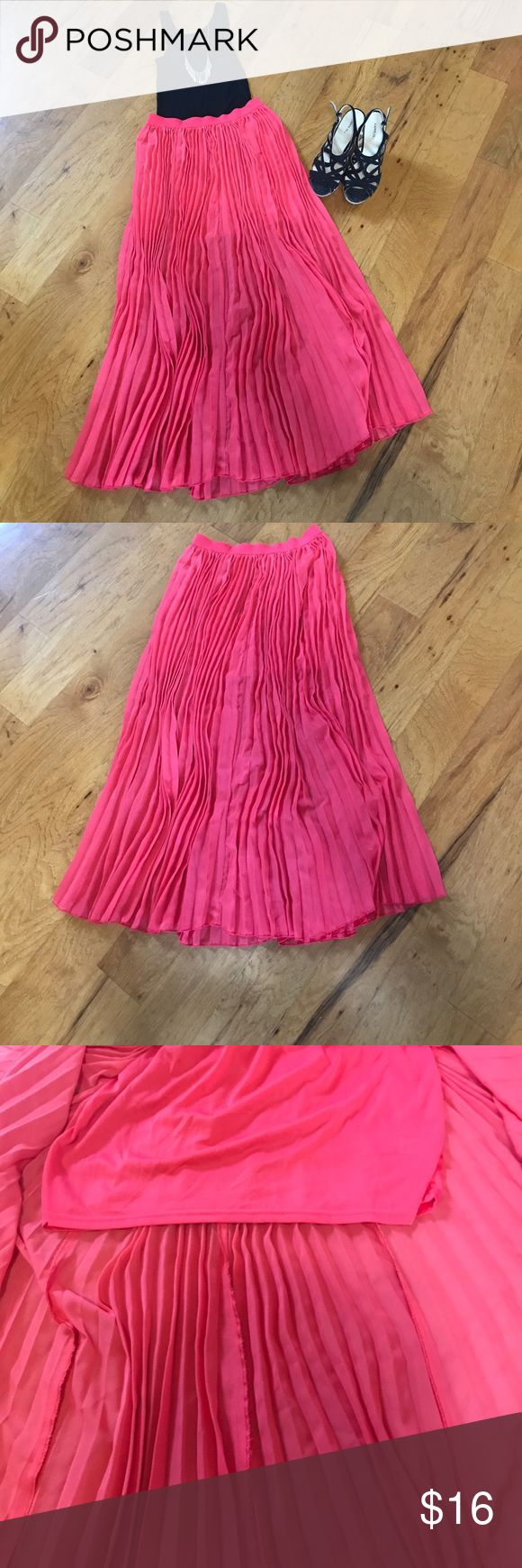PRICE DROP! Salmon Pleated Maxi Skirt Beautiful salmon colored pleated Maxi Skirt. Only worn a few times. The outer layer is 36 inches long and the bottom layer is 14 1/2 inches long. The waist is 27 inches. Skirts Maxi