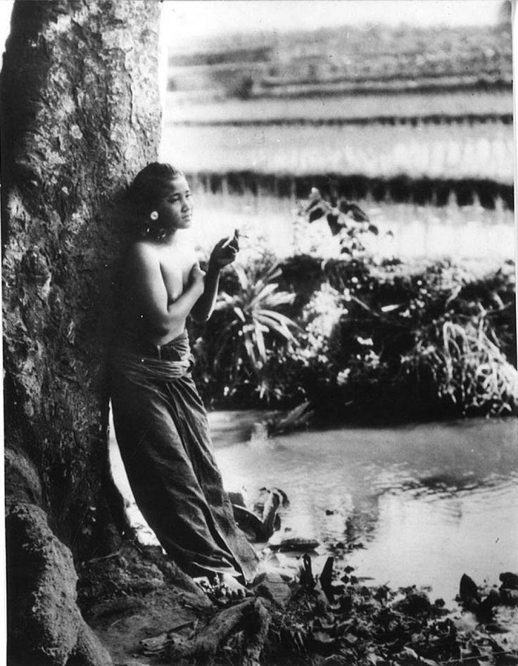 Smoking Balinese girl, circa 1930