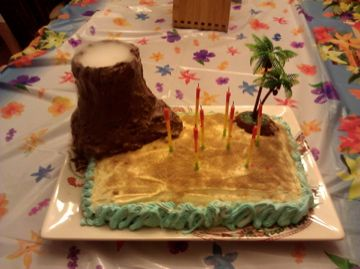 Volcano Cake  Use rice krispies to form the volcano around a glass vase - frost with chocolate frosting - raw cane sugar for the sand - and use dry ice for the smoke! #volcanoparty #volcano #island #luau #birthday