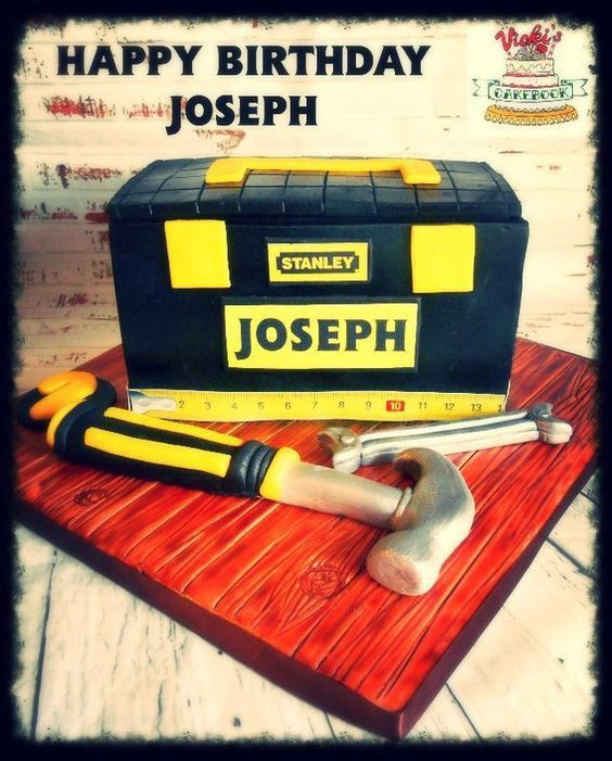 3d toolbox yellow and black like a classic stanley tool box with sugarcraft hammer and spanner on floorboard style cake board Toolbox Cake