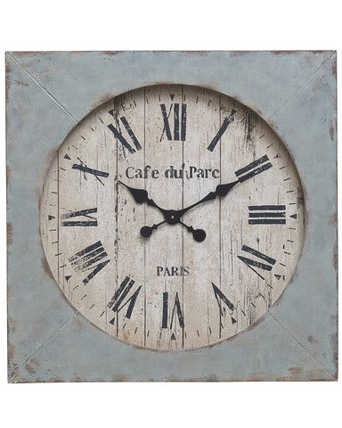 an attractive and unusual large wall clock in wood and metal the central circular face