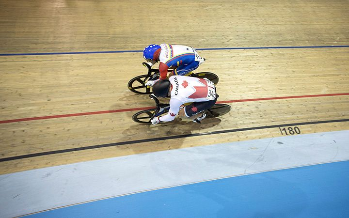 Canada's Hugo Barrette competes against Venezuela's Hersony Canelon Vera during the men's sprint semifinals at the Pan Am games in Milton, Ont., on Saturday, July 18, 2015. Barrette would go on to win the gold medal race.