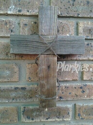 Wooden cross with barb wire