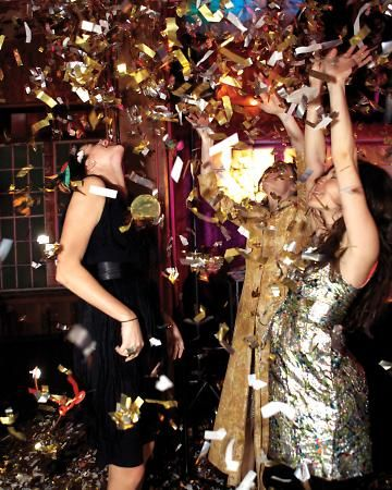 Partygoers go wild as confetti cannons blast off to celebrate the start of 2012 at this real wedding.