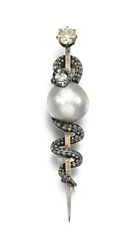 Pearl and diamond brooch, circa 1860. Designed as a coiled snake holding a button-shaped pearl, the head inset with a cushion-shaped diamond, the tail highlighted with rose stones, to cabochon ruby eyes, and a circular-cut diamond surmount, French assay marks.