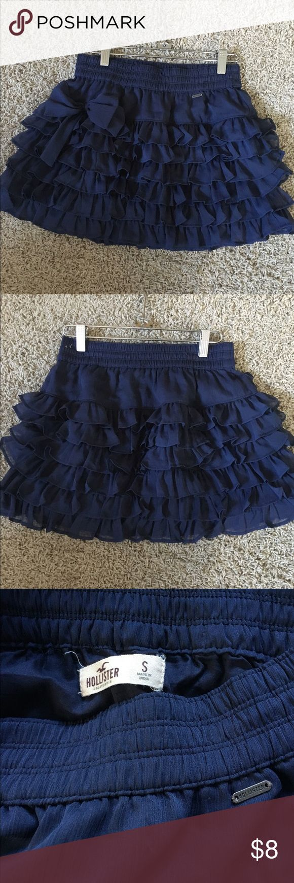 Hollister skirt Navy colored ruffle layer skirt from Hollister. Cute bow on the right side. This skirt is relatively short. Hollister Skirts Mini