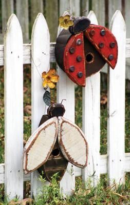 Handmade Wooden Lady Bug Bird House ($49), adorned with rustic and recycled accents.  I think i may try to make these!