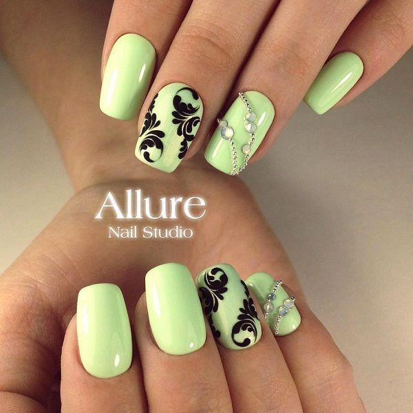 Very soft and bright green color, which is the border with yellow, with black details on nail per finger, and rhinestones on one nail of both hands.