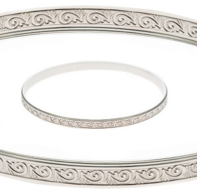 This round, solid bangle has a pretty embossed pattern all the way around the outside.  The inside is perfectly plain and can be personalised with hand engraved names, dates or a message.  Custom Made for you in Australia in the size and metal you would like. Sterling silver prices are provided below, please contact us if you would like a price for 9ct or 18ct yellow, rose or white gold.