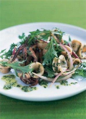 Squid salad with lime, coriander, mint and mizuna. Ingredients: squid, oil, coriander, garlic, fish sauce, sugar, green chilli, lime, mizuna or rocket, red onion. Recipe on Nigella.