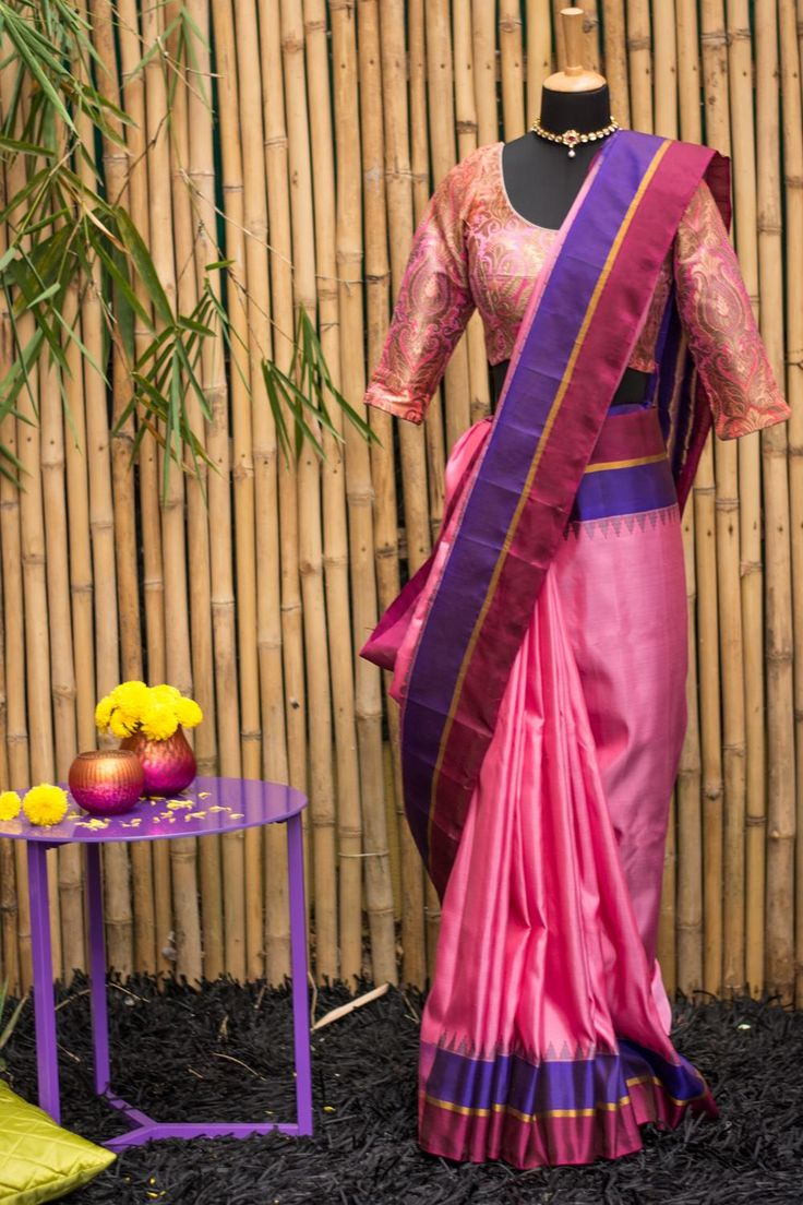 Which girl does not like pink? This bright pink Gadhwal pure silk saree comes with a border in a contrasting purple and maroon with grey temple motif touches, ensuring that the look is not too girlie while being sweetly feminine. The pallu strikes out in a rich golden sheen on purple.   #houseofblouse #festive #saree #puresilk #blouse #indianwear #india #fashion #bollywood