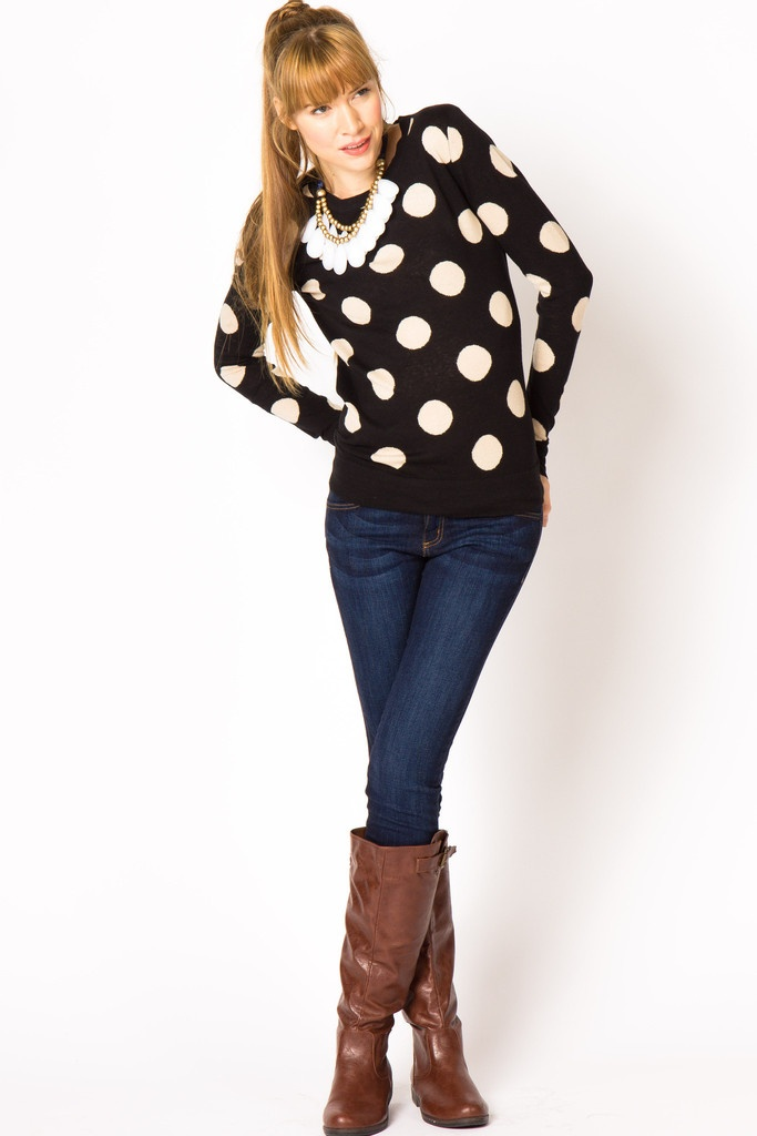 Black sweater with large white polka dots. Skinny jeans. Tall brown boots.