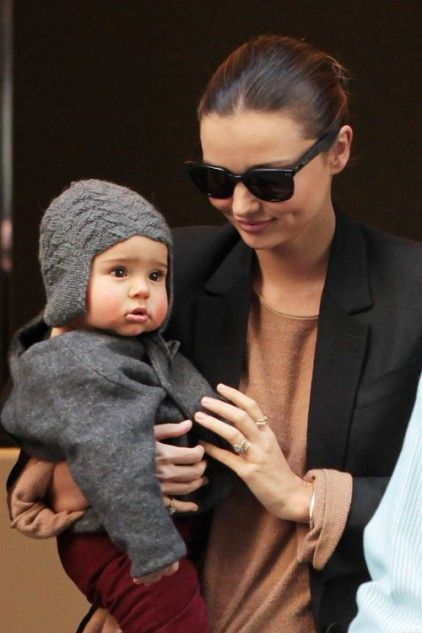 If only I could look as chic as she does out with my baby...