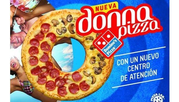 I'm heading down to Guatemala because that's where you can get this pizza shaped like a donut. It's on sale at the Domino's establishments in that country. Fill the hole with chicken wings? I was thinking about bourbon-flavored meringue. But that's just me.Link -via Foodbeast...