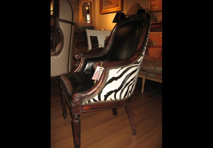 Luxury furniture leather zebra chair. Bernadette Livingston Furniture LLC offers a superb collection of high end furniture and furnishings.