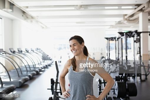Stock Photo : Laughing woman looking away at gym