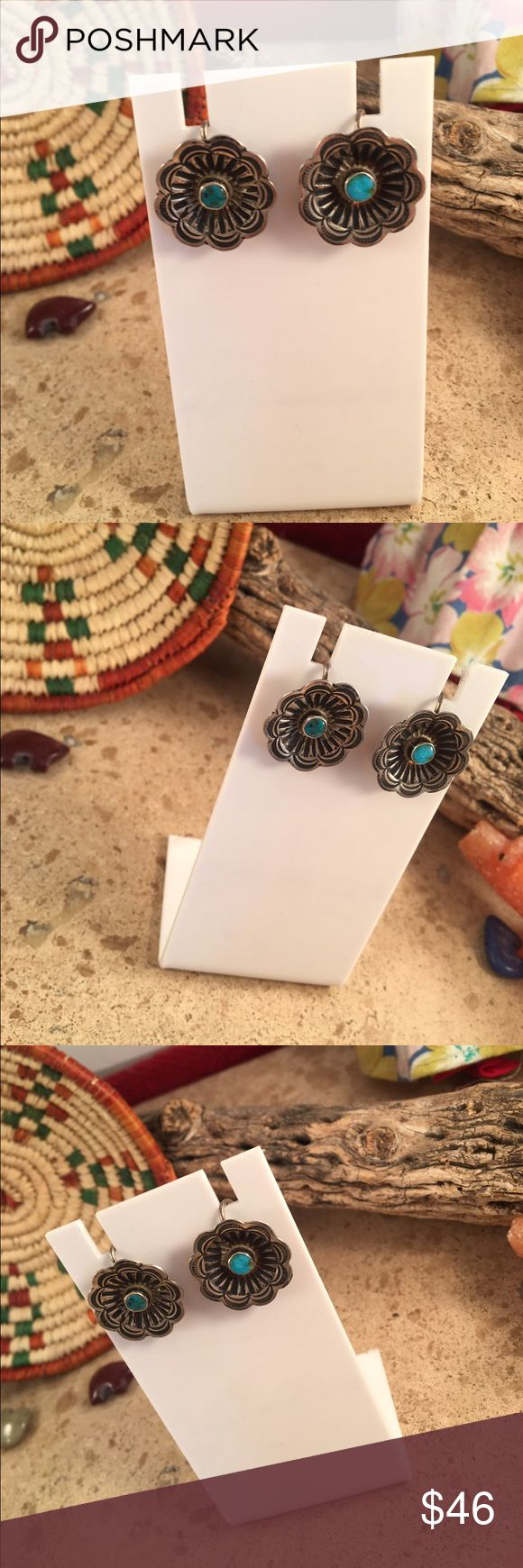 Vintage Navajo Turquoise Screw Back Earrings These are a pair of Vintage Navajo Sterling Silver and Turquoise flower screw back earrings. They are right at 3/4 of an inch wide. They are in excellent condition.   Thanks for looking please contact me with any questions. Jewelry Earrings