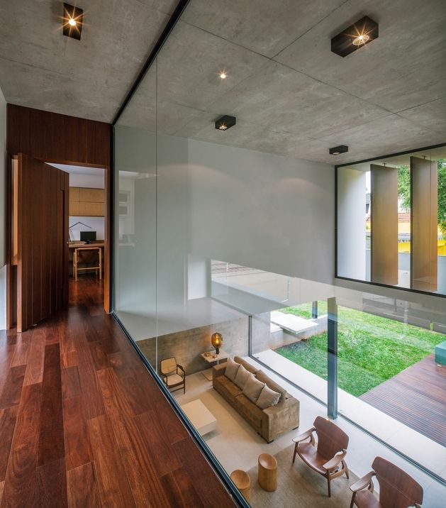 dual-direction-concrete-home-surrounds-poolside-courtyard-brazil-9-glass-mezzanine.jpg