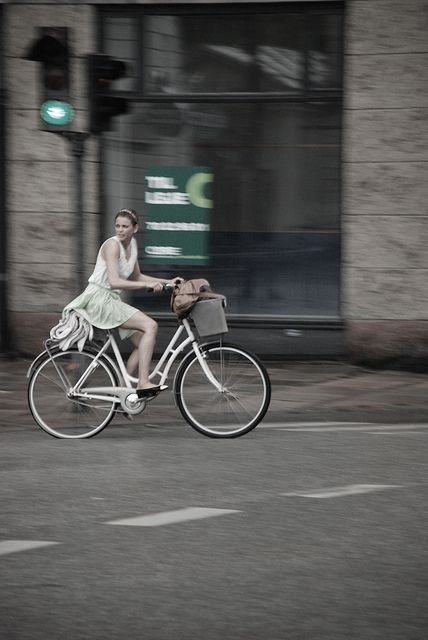 Cycle chic in the summer rain by Anne Katrine Harders, via Flickr