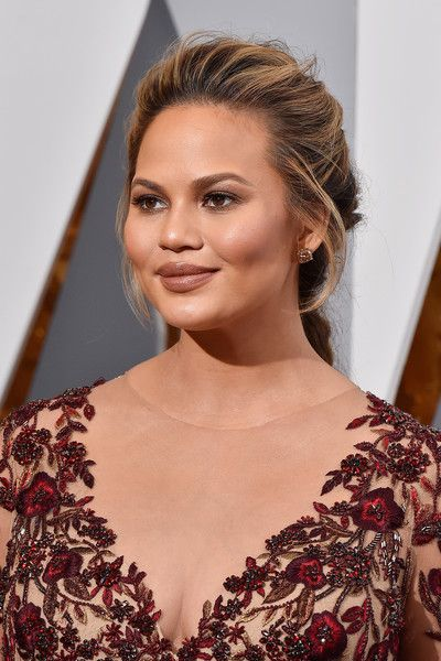 Chrissy Teigen Loose Braid - Chrissy Teigen wore her hair in a romantic loose braid during the Oscars.