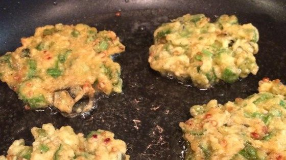 These fried okra patties are made from fresh okra and onion in a cornmeal batter. A delightful southern-style snack.
