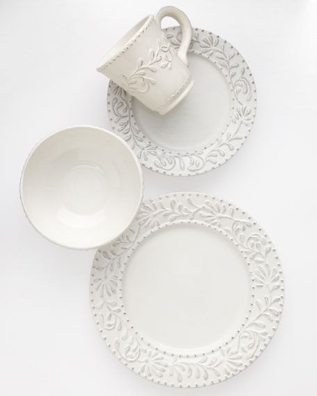 """Ceramic dinnerware with an antique-white finish. 16-piece service for four includes 11""""Dia. dinner plates, 8.25""""Dia. salad plates, 6.5""""Dia. soup bowls, and 14-oz. mugs. Dishwasher and microwave safe."""