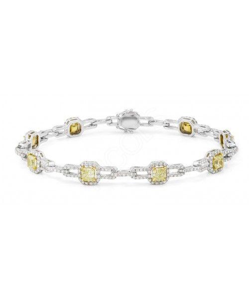 Pulsera diamantes Canary Yellow amarillos, múltiples orlas recto que centran la atención en los diamantes amarillos centrales. Atrevida y especial para una mujer supertrendy. Oro blanco 18kt, diamantes blancos 1.95ct y diamantes amarillos 3.85ct.