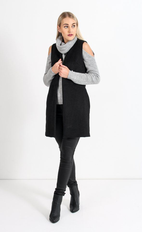 Embrace luxe layers with this Longline Gilet for a style statement this season. Wear over any outfit on cooler days for a chic look.