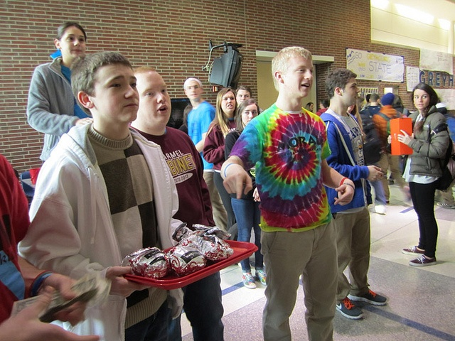 EAT MOR CHICKEN, RAISE MOR MONEY: On Feb. 20 sophomore Henry Curts sells Chick-fil-a breakfast sandwiches to students during the late start. All proceeds will go to the Carmel Dance Marathon, which raises money for Riley Hospital for Children. KATHLEEN BERTSCH / PHOTO