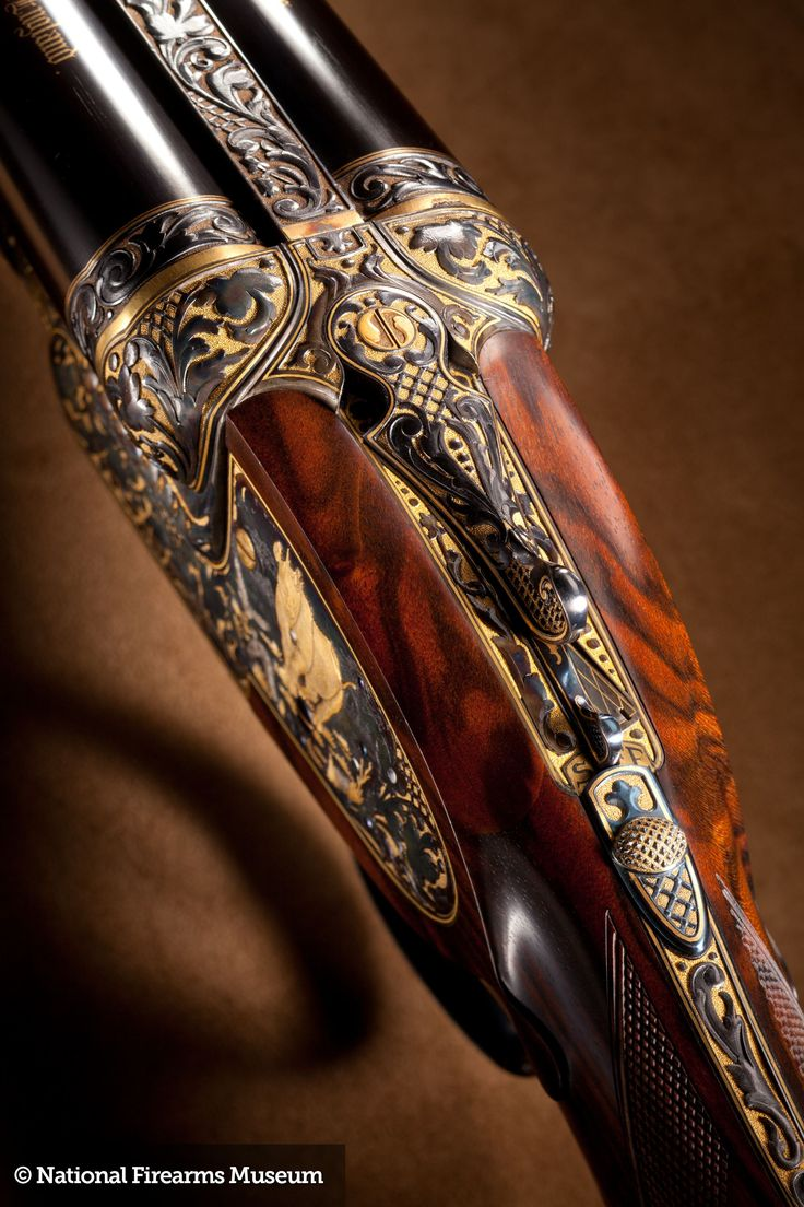 A stunning J. Purdey & Sons double rifle in .600 Nitro Express. Engraved by Philippe Grifnee with a gold Rhino, Elephants and a stand of Cape Buffalos. The gold background inlay gives the gun a unique appearance and is tastefully set off by the deep relief engraving of the African game scenes.