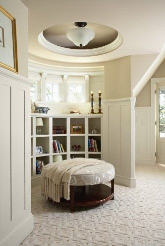A curved bookcase creates the perfect nook in a master bedroom. Interior