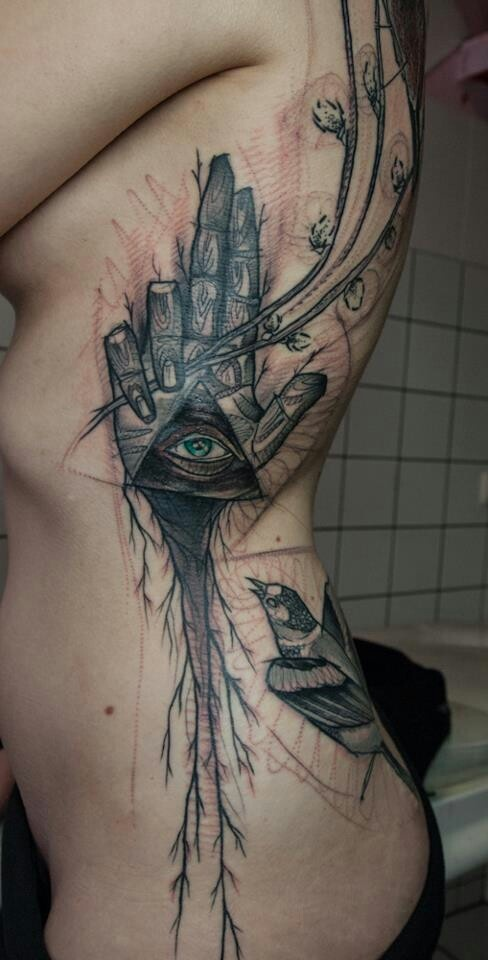 Beautiful rib piece trash polka tattoo inked for Modern art tattoo