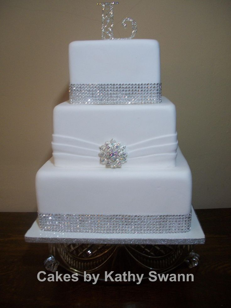 Square Wedding Cakes. Lov that it is sitting on a class base