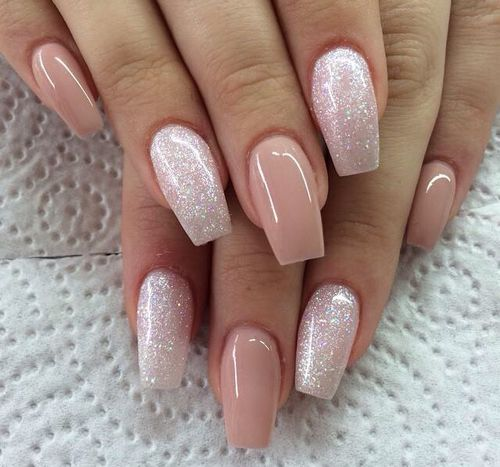 Glossy nude pink and sparkly manicure.
