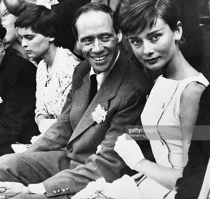 June 11, 1955: Mel Ferrer and his actress wife, Audrey Hepburn (Right) are shown as they attended thier first bullfight (controversial, but this was the olden days!!!) in Madrid. At left is Lucia Bose, Italian actress wife of retired bullfighter Luis Miguel Dominguin, host of the American couple.
