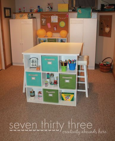 no instructions, but a pretty basic table using 6 cube organizers and an MDF slab. :)