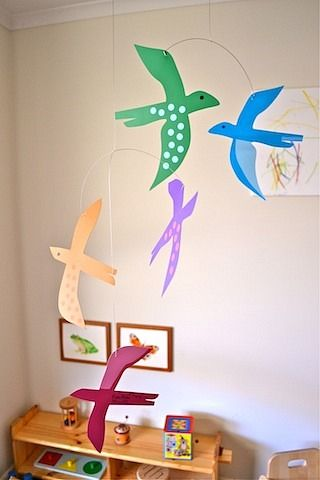 A bird mobile in a Montessori-inspired bedroom. http://www.pukapuka.com.au/products/bird-mobile-in-spectrum-colours $45