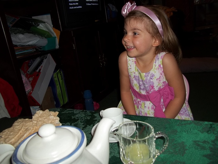 Having our first tea party in our living room at Fiona's table