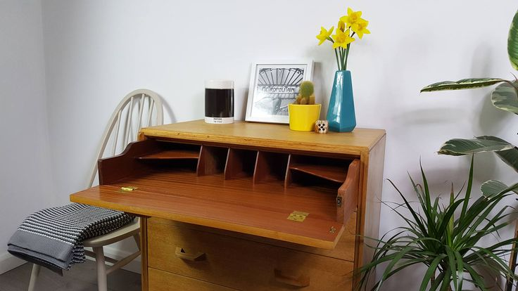 This set of drawers has been refinished, is immaculately clean and shows very little sign of its age. Firm & solid, the pull down writing desk is a useful accessory in compact spaces.  The approximate dimensions are:- Width - 30 inches Depth - 18 inches Height - 35 inches