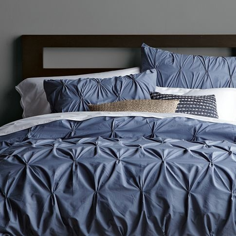 Gray wall with blue bedding