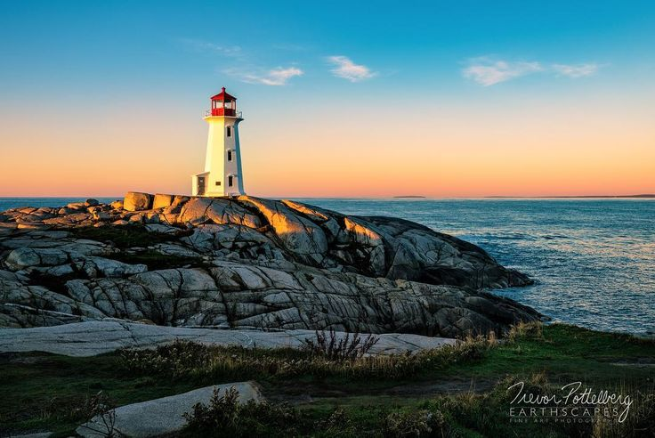 One of the most iconic lighthouses in Eastern Canada rests on the rocky shores of Margarets Bay in Peggys Cove Nova Scotia. This piece is titled Good Morning Peggy - Order 634 -  captured just as the rising sun broke over the horizon and cast it's warm amber glow onto the lighthouse.